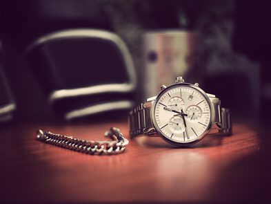 Wrist watch on a wooden table